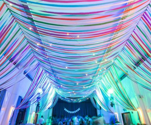 colourful-ribbon-canopy-wedding-reception-town-village-hall-celebration-beautiful-oculux-lighting-evening