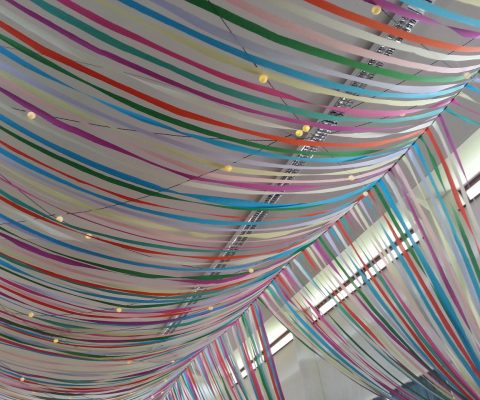 colourful-ribbon-canopy-wedding-reception-town-village-hall-celebration-beautiful-oculux-lighting-globes