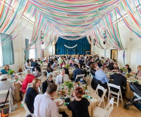 colourful-ribbon-canopy-wedding-reception-town-village-hall-celebration-beautiful-oculux-lighting-guests