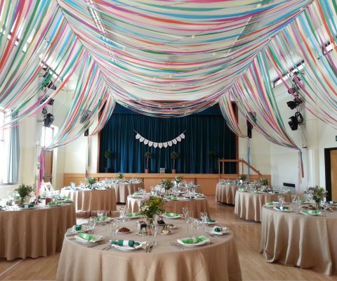 colourful-ribbon-canopy-wedding-reception-town-village-hall-celebration-beautiful-oculux-lighting-guests2