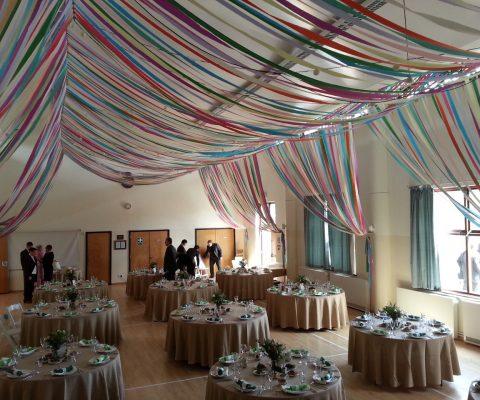 colourful-ribbon-canopy-wedding-reception-town-village-hall-celebration-beautiful-oculux-lighting-guests3